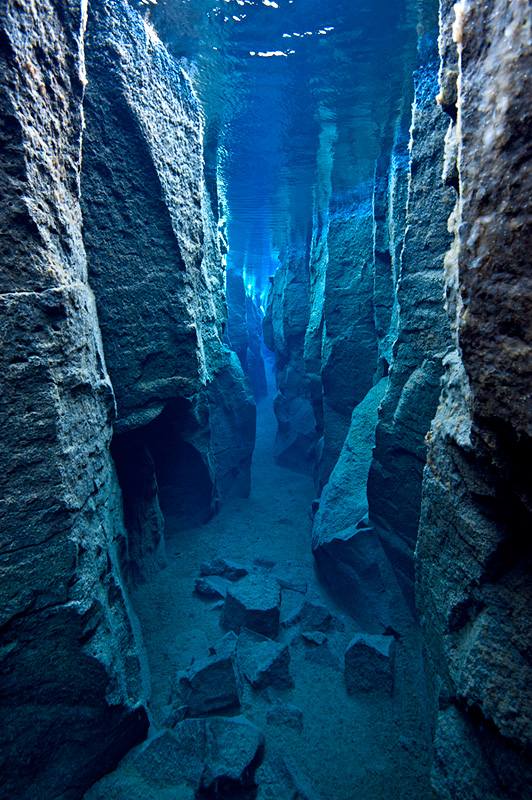 A view through the narrow Nes Canyon, near Husavik, north west Iceland. This canyon is formed by a fault  in Iceland's volcanic landscape that has filled with glacial spring water.